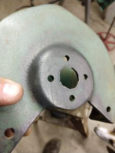 Ouch - Cracked cast iron guard needs repair.